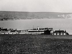 Click to view The Downs and the Pier with a Paddle Steamer