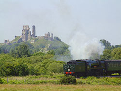 Steam train leaving Corfe Castle - Ref: VS614