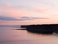 Click to view Sunset at Kimmeridge Bay