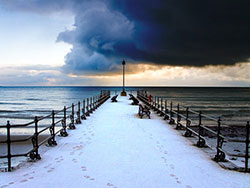 Click to view Snow on the Jetty with Dark Skies