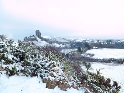 Click to view Corfe Castle in the Snow on the Purbeck Hills