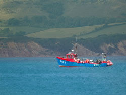 Click to view Fishing boat in Swanage Bay