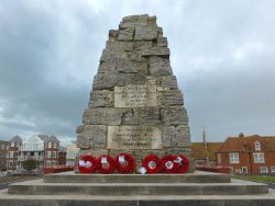 Click to view Poppies resting on the Swanage War Memorial
