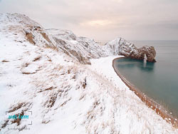 Click to view Durdle Door Snow
