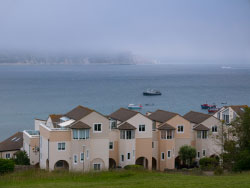 Click to view Low mist over Swanage Bay