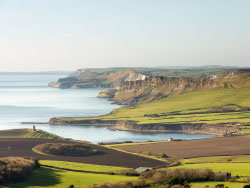 Click to view Looking down across Kimmeridge Bay