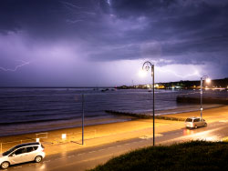 Click to view Lightning over the bay from Sandpit Field