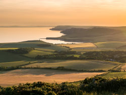 Click to view Sunset over Kimmeridge Bay