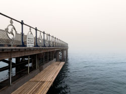 Click to view Fog at the pier walkway
