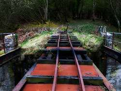 Click to view Disused rusty tram tracks on bridge
